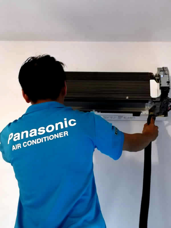 Cleaning AC with powerful vacuum